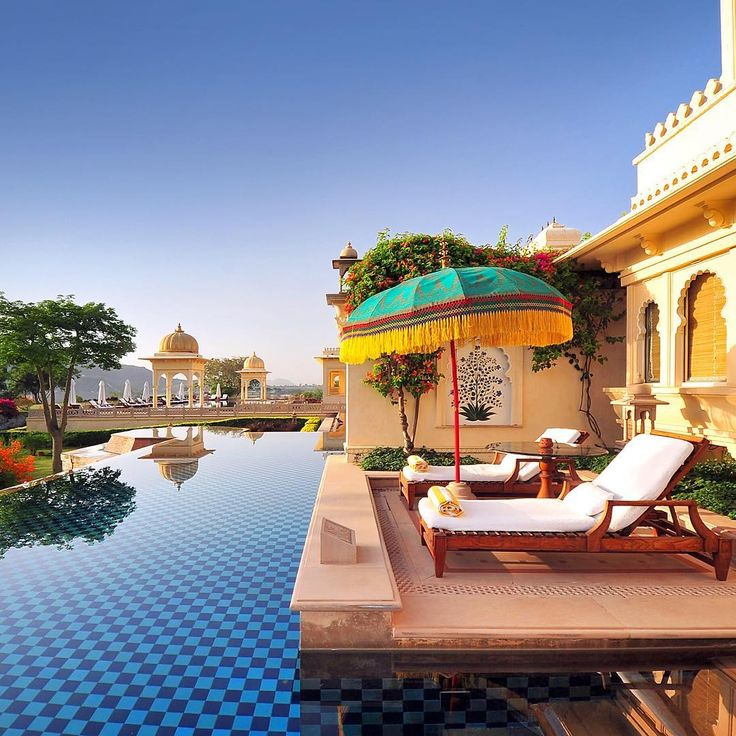 Our loungers and a stretch of the swimming pool at the Oberoi Udaivillas in Udaipur, where we stayed when touring Rajasthan. We had a nice view over the Lake Pichola!  Photo © TravelPlusStyle.com