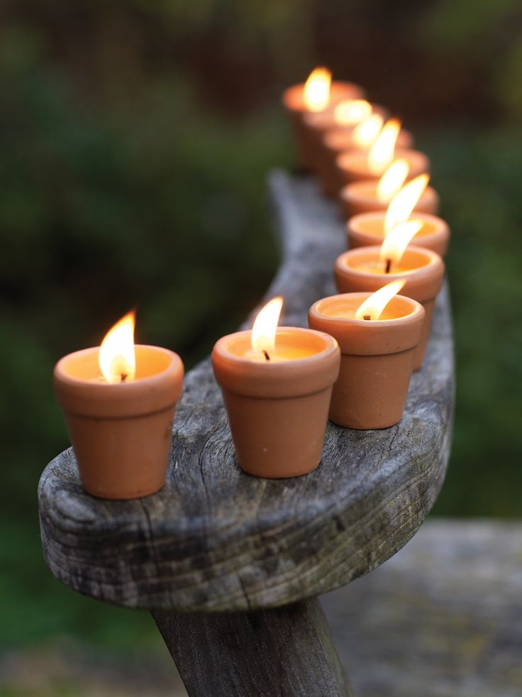 Citronella Candles - Outdoor Living.  Easy look to make too, just put angles in terra cotta mini pots