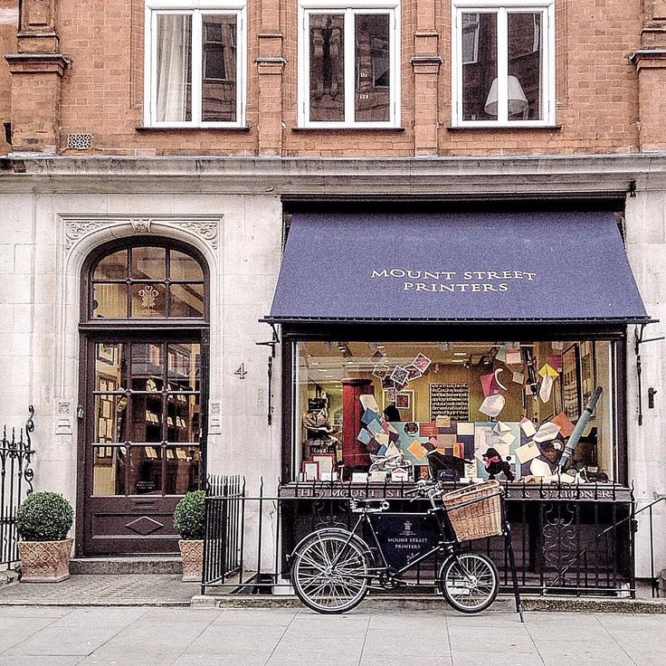 n_and_outside_london Mount Street Mayfair. Stationary shops are my absolute favourite 💌📒🖋📓🖌. My first job when I moved to London almost 5 years ago now was as a shop assistant in a stationary shop and I can assure you that I used to spend half of my salary buying the products that I was supposed to sell 😁.... So, I couldn't really the resist this #shopfront especially when it features a lovely #bicichic 🚲 😊  #prettycitylondon