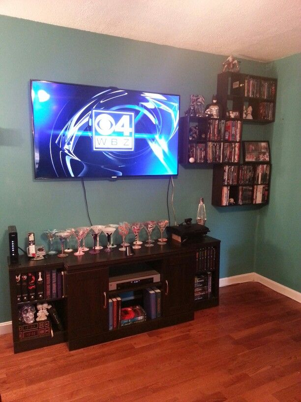 Just did this DIY project for media storage. Using the botton half of and old entertainment unit, we wall mounted the tv and used mini cubes from Target ($15 a piece) DVDs, ect. fit PERFECTLY.!