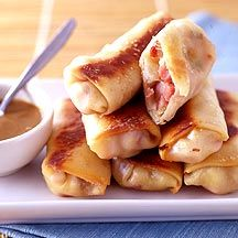 We put a new spin on the classic French combo of ham and cheese by turning it into egg rolls. Dipped into honey mustard, the rolls make a great afternoon snack. #recipe #WWLoves