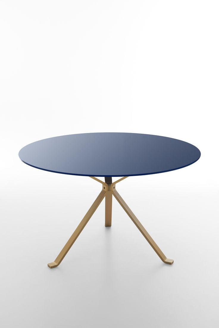 Revo table coll Reflection with round sea blue glass top + satin gold legs. Product design by CMR.Color design and finishes by Raffaella Mangiarotti #focusoncolor #living #shining