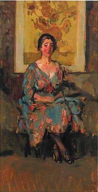 Isaac Israëls - Portret van een vrouw, zittend voor de Zonnenbloemen van Van Gogh