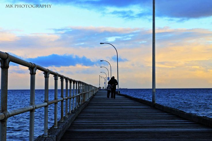 MK Photography Winter by the water Beautiful seeing father and son walking along the pier.