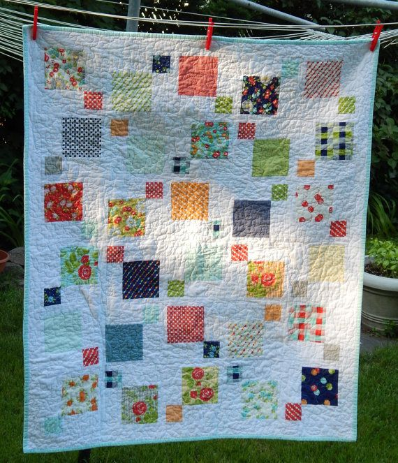 Happy Go Lucky Baby Quilt   Handmade by SolsticeQuilting on Etsy (disappearing 9 patch with sashing)