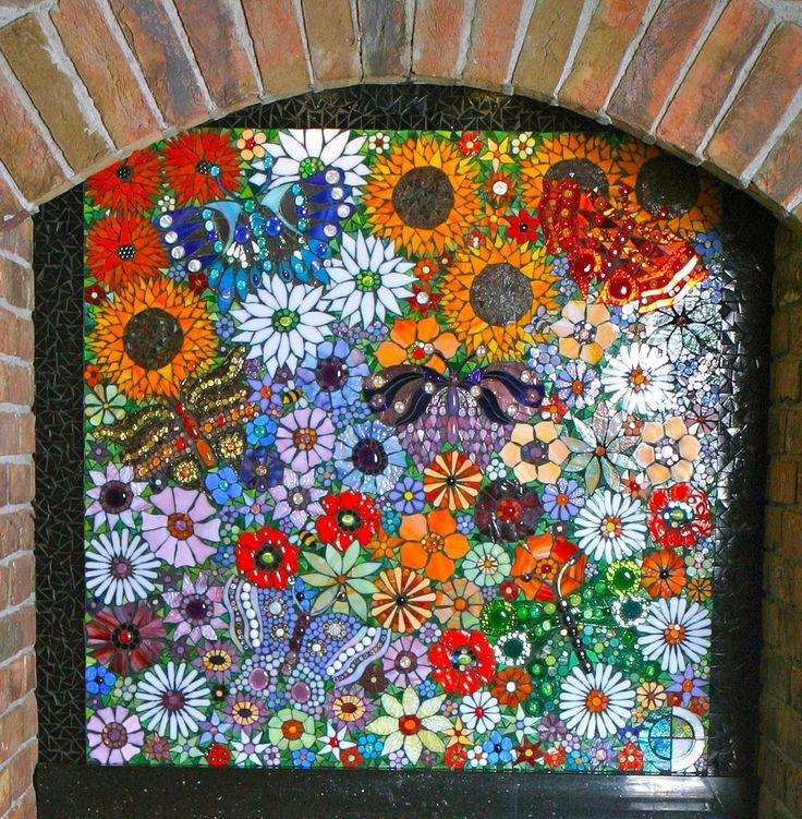 Mosaic fireplace screen of flowers