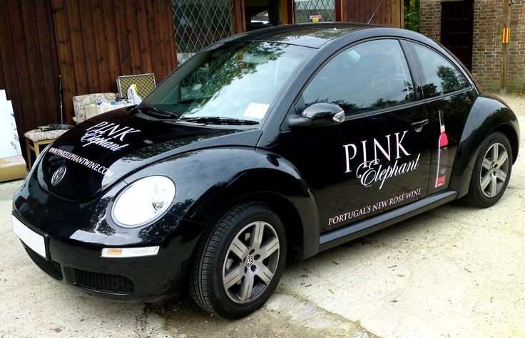 Pink Elephant VW Beetle with printed vinyl graphics.