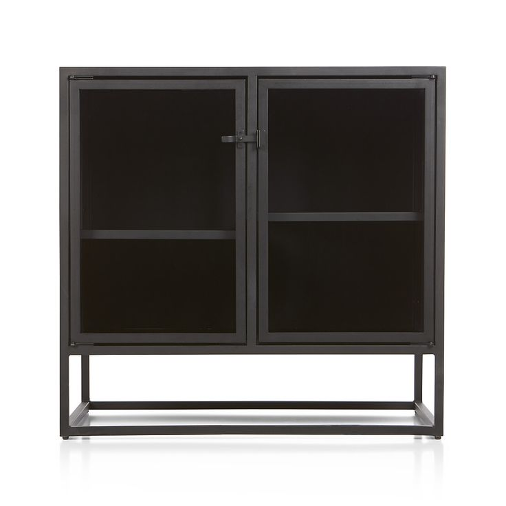 Designed by Paul Schulman of Schulman Design, Casement takes inspiration from the clean lines of vintage French casement windows. With a black steel frame latched with simple industrial hardware, small sideboard's narrow silhouette allows for maximum storage behind clear glass doors.