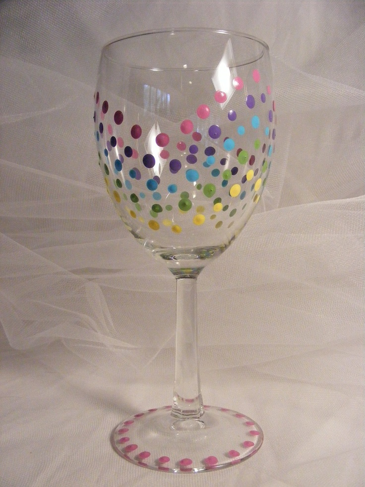 Painted birthday wine glass with a rainbow of multi colored polka dots