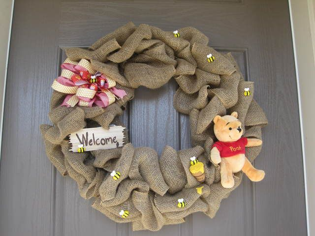 Burlap welcome wreath at a Winnie the Pooh birthday party! See more party ideas at CatchMyParty.com!