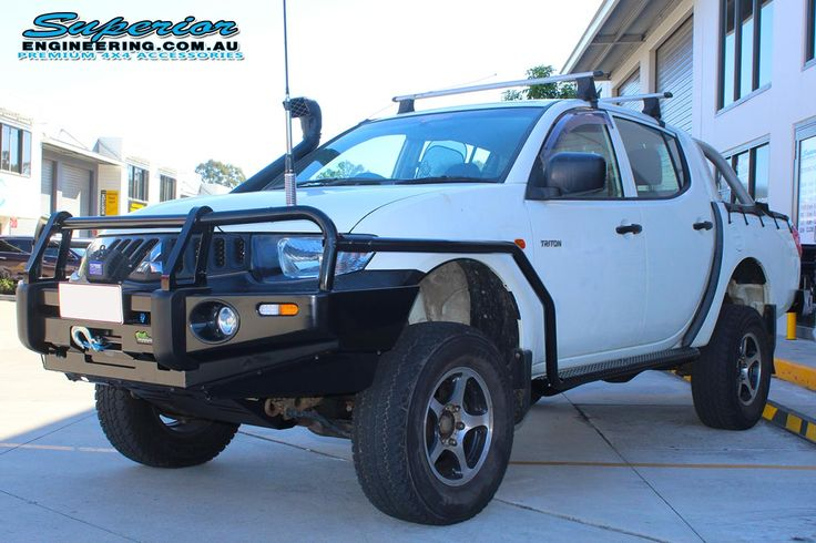 Mitsubishi Triton ML (Dual Cab) #OnTheHoist at #SuperiorEngineering Fitted with side steps, bullbar, rearbar, snorkel & engine guard