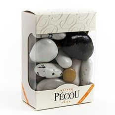 Dragees River Stones Gift Box by Pecou  This unique French treat is a mix of assorted almonds, marzipan, dried chocolate covered apricots, and chocolate candies in the shape of riverstones. These chocolate pebbles are both cute and delicious!