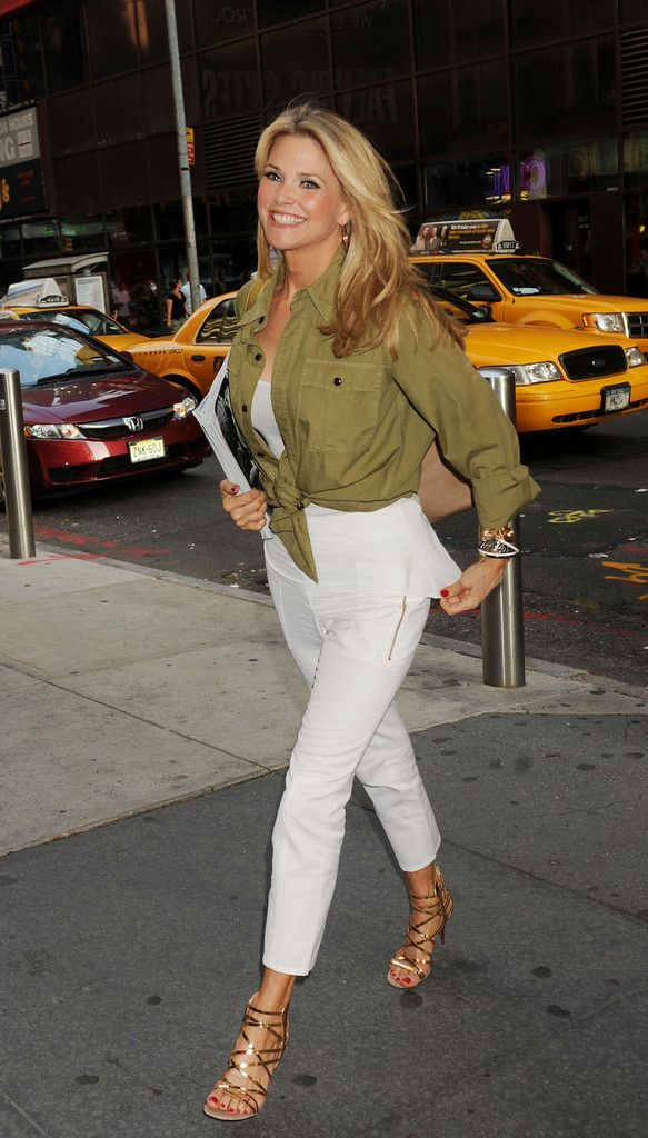 Christie Brinkley Button Down Shirt - Christie Brinkley was glowing, as per usual, in on her way to the theater for her Broadway show Chicago. The model wore cropped white pants to show off her gold strappy stilettos while her blonde locks were worn down for an easy breezy style.