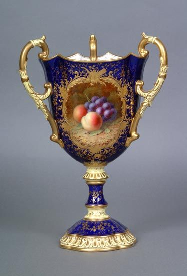 This three-handled chalice was painted by Frederick Chivers, who with his colleague Fred Howard painted rich and rounded still-life studies of fruit. This example dates from c1910.