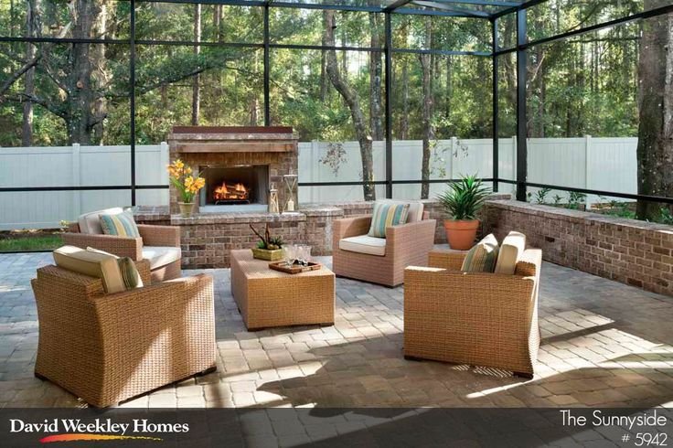 Enclosed lanai with stone flooring and brick fireplace in for Lanai flooring options