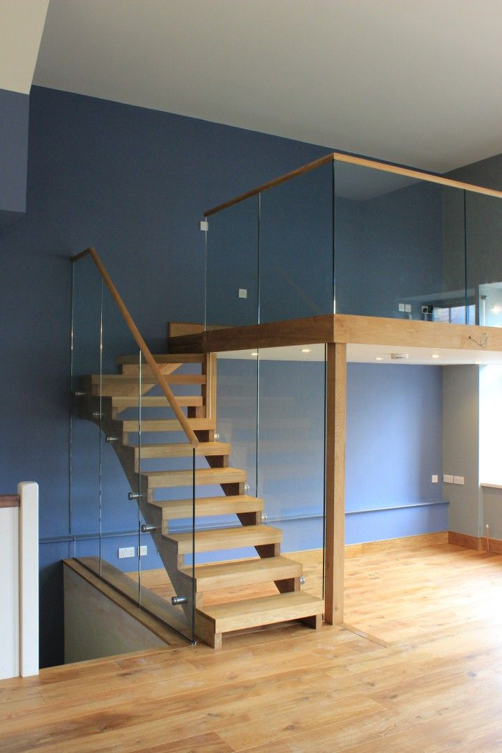 Oak staircase with frameless glass handrail with stainless steel bolted fixings