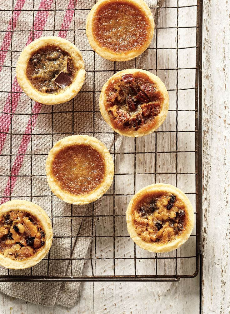 Make your own delectable custardy tarts instead of buying them. We've subbed in the very Canadian ingredient maple syrup for the more common corn syrup. Plus, we've included variations on the classic, with chocolate and pecans instead of raisins.