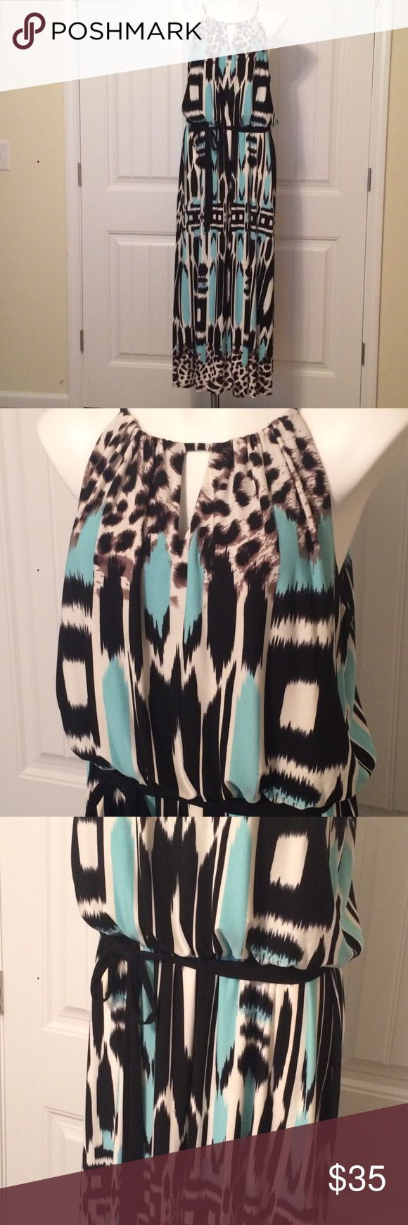 Turquoise animal print maxi Animal print maxi dress in Aqua blue, brown, whit & black. Soft poly knit for easy wearing.  Has soft elastic at waste, with soft sash tie belt.  Button closure at back. NWT Roz & Ali Dresses Maxi
