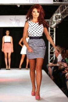 Amy Childs struts her stuff on the catwalk as she models new range