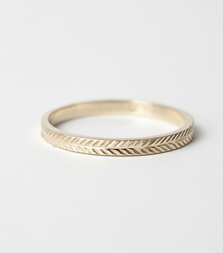 A beautiful wheat-patterned ring in 14k gold. Looks beautiful stacked with your other rings! See the men's version here.