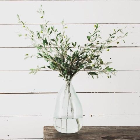 "Olive Stems have become one of my favorite things to decorate with. They look good in any vase and throughout the year for every season! Sold as a set of three. Each Stems Measures: 36"" Long"