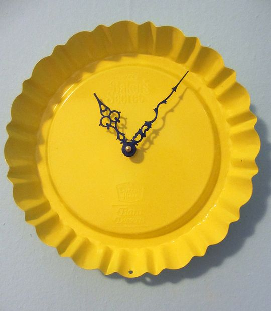 Clock made from old Duncan Hines dessert pan (antique store) + Rust-Oleum Painter's Touch paint (in Sun Yellow & Deep Blue) + Clock Movement Kit
