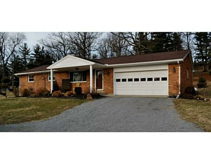 Attractive brick ranch home situated on a nice shaded for Brick garages prices