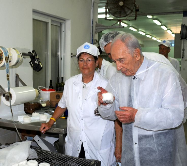 President Shimon Peres (z''l) tastes kosher cheese in a dairy factory during Shavu'ot in Kfar Haroe, Israel; 2011.