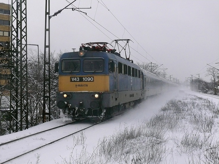 Through the snow, hungarian train is arriving to Budapest station