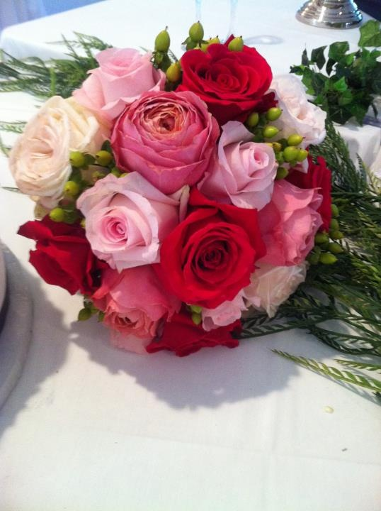 Bridesmaid bouquet of pink peonies, light pink and hot pink roses