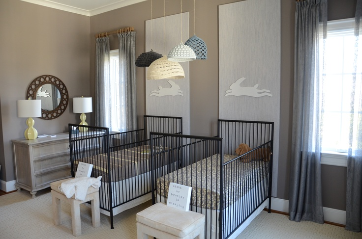 Taupe boy-girl twin nursery with modern iron cribs