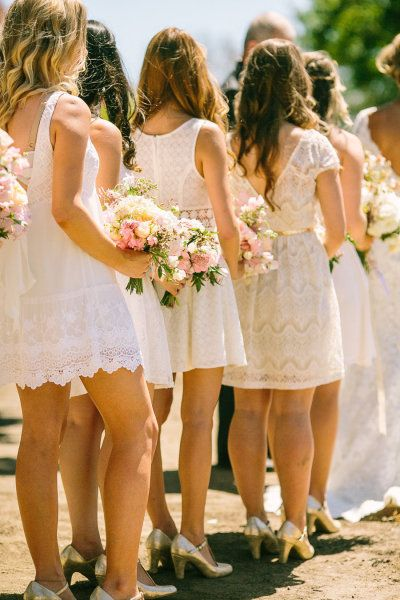 Maids in their choice of white/lace/eyelet dresses. Photography by daniellecapitophotography.com  Read more - http://www.stylemepretty.com/2013/08/06/santa-margarita-ranch-wedding-from-danielle-capito-photography/