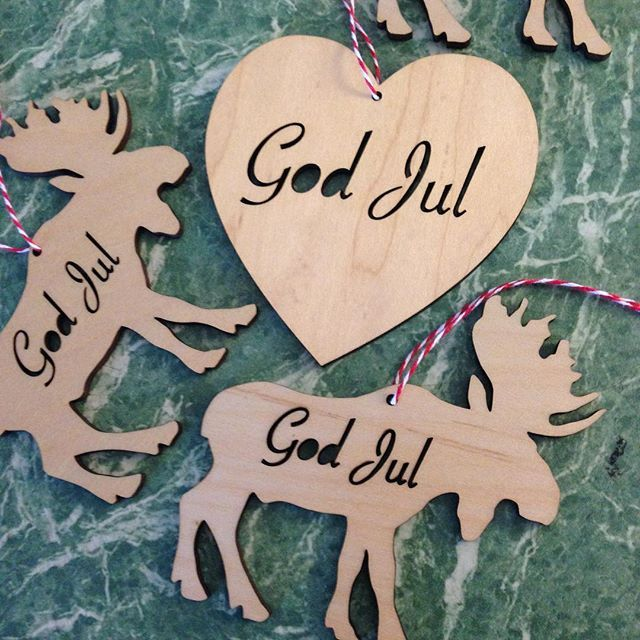 GOD JUL = MERRY CHRISTMAS in Swedish Norwegian and Danish. Available only @scandinavianfestival . The Christmas tree decoration Moose and the Heart are made in birch. Very Scandi! Make sure you come early they sold out last year.#scandinavian #scandinavianfestival #scandinavianmarket #scandi#nirdicinspiration #nordicdesign #nordicinterior #scandinavianchristmas #moose #älg #heart#godjul