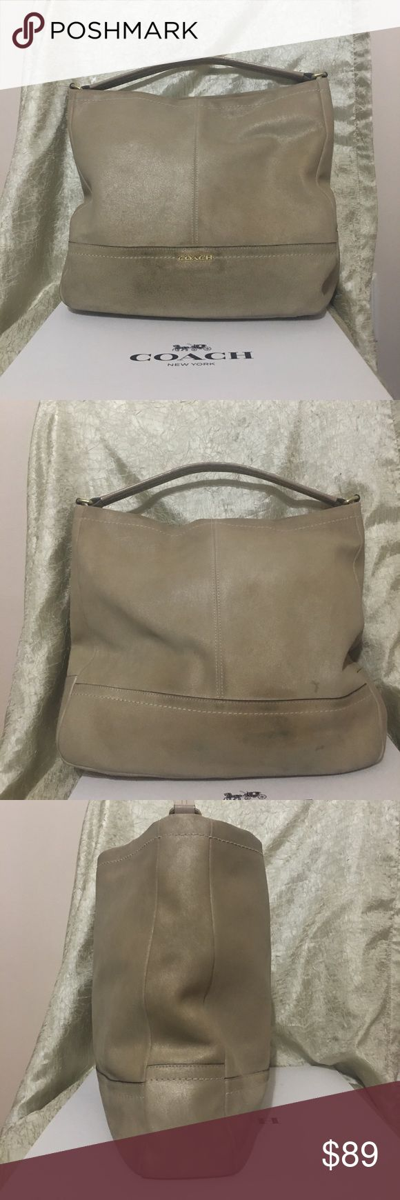 Coach Parke hobo You are looking at a beautiful authentic Coach Park side Hobo style # 37120 in the color of sand. The bag is made of a suede feeling brushed leather and has a short This bag is sand in color but has a gold flake to the color BEAUTIFUL BAG more of a gold to me. Does have some dirty spots that would most likely clean right up with the coach leather cleaner. Plastic coating on leather strap is starting to peel. Inside is perfect. Coach Bags Hobos