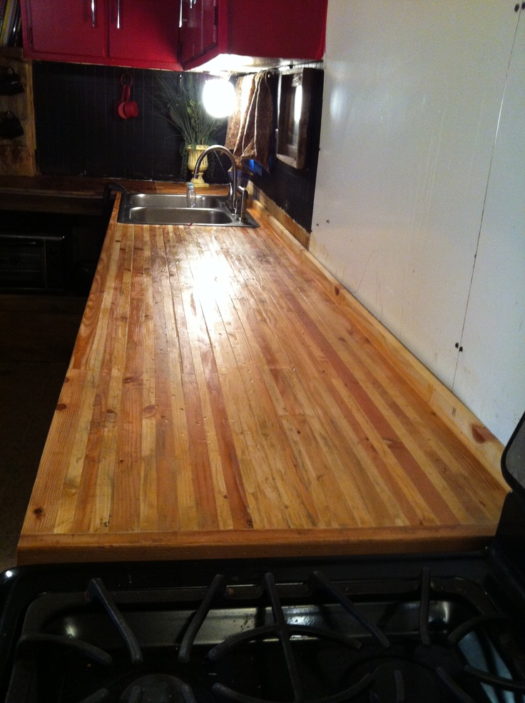 DIY butcher block counter made with cuts from yellow pine 2x4's and white pine 1x8's. nailed and glued together,