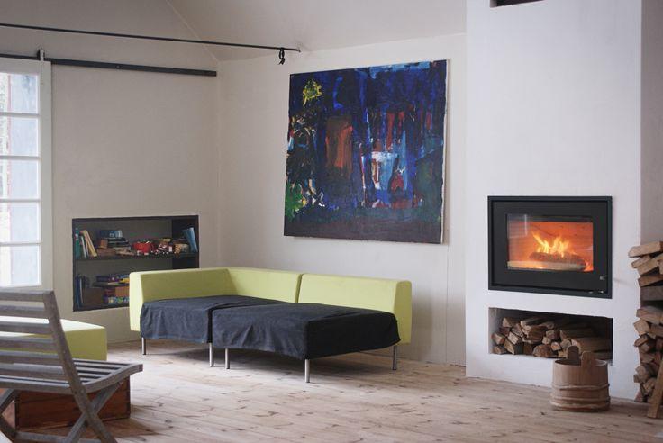 A #Rais Stove next to beautiful #art.  #personal #Style #Rais #Design #Art
