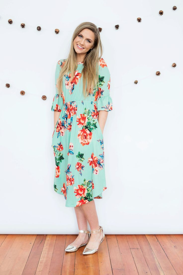 Our Sydney dress features one of our best selling styles of dresses, but with a fun ruffle sleeve detail! The floral print is gorgeous, it has pockets, an elastic waist to give it shape, and the fabric is amazing! Super soft and thick, so no slip is needed! It can be dressed up with heels or worn more casually with flats. Great quality for a great price! Model is 5'7'' wearing size Small