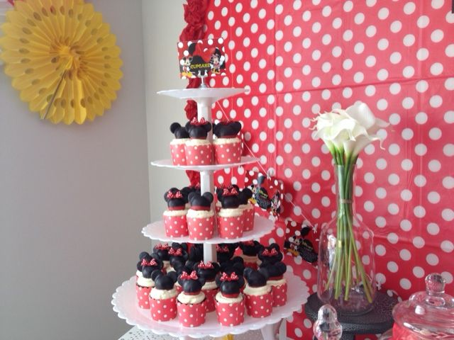 Mikey & Minnie Tower. Mikayla Turn 1. Cupcakes are red velvet topped with mickey & minnie's cake pop.
