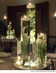 Calla lilies in water with candles