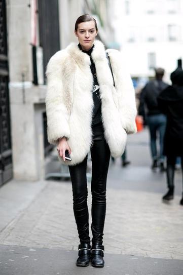 model off duty: paris street style - oversized winter white fur coat + leather pants.