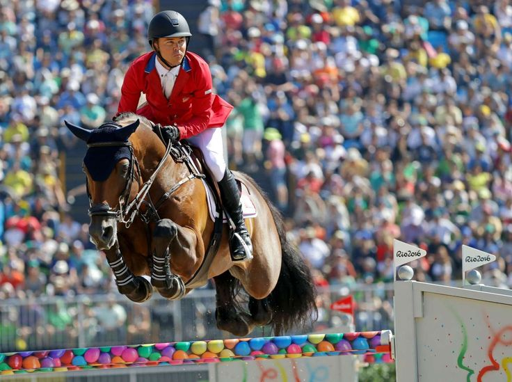 Best images from Aug. 14 at the Rio Olympics:     Kent Farrington of United States rides Voyeur during the equestrian open jumping qualification in the Rio 2016 Summer Olympic Games at Olympic Equestrian Centre.