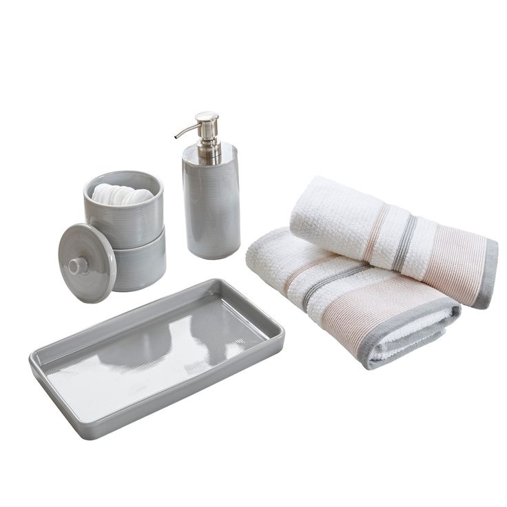 Tie your bathroom together with this Gray Bath Coordinate Set. It comes with everything you need to decorate your countertop including a dish for your soap, two small hand towels, a soap pump and a cotton ball jar. The neutral colors will go with almost any look you're going for so it'll be easy to find coordinating bath mats and a shower curtain.