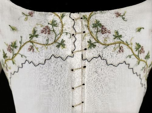 Detail front, caraco and petticoat, 1790-1800. Very fine white cotton, embroidered with garlands of vine and grape clusters.