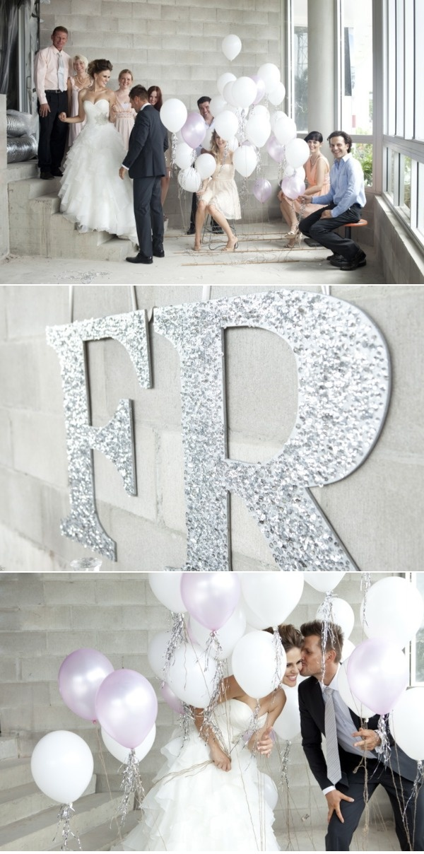 Monogrammed initials in silver glitter and white balloons with silver fringes make simple but stylish wedding decor and photography props