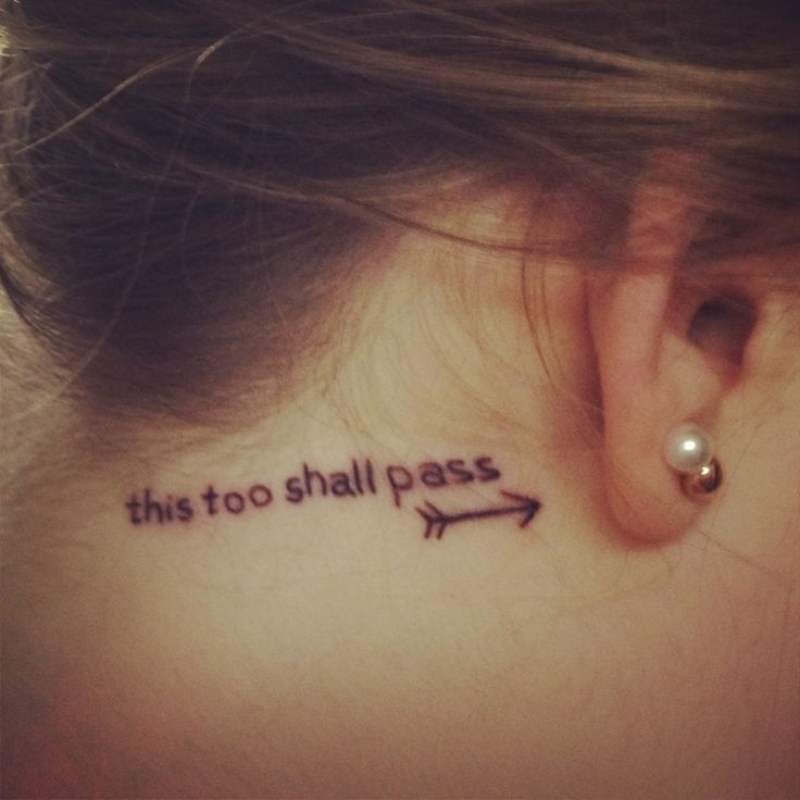'This too shall pass' behind the ear tattoo with an arrow. My first tattoo! I love it! :) symbolizes how much I've been through and how no matter how hard a situation gets it will pass. The arrow symbolizes being pulled back by life only to remember that I will be launched into bigger and better things. Love!!! :)