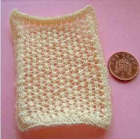 Knitting pattern for a 1:12th scale Pram Blanket