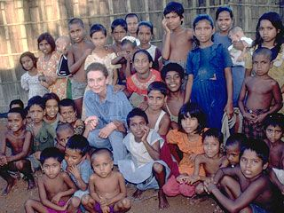 Audrey Hepburn joins children outside a school in Dhaka, the capital of Bangladesh. During her 1989 visit to Bangladesh, she toured UNICEF-supported immunization, water and sanitation, and formal and non-formal education projects.