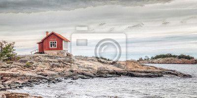 Fotobehang rode huis op zee kust in doffe kleuren bij de herfst - autumn • pixers.nl