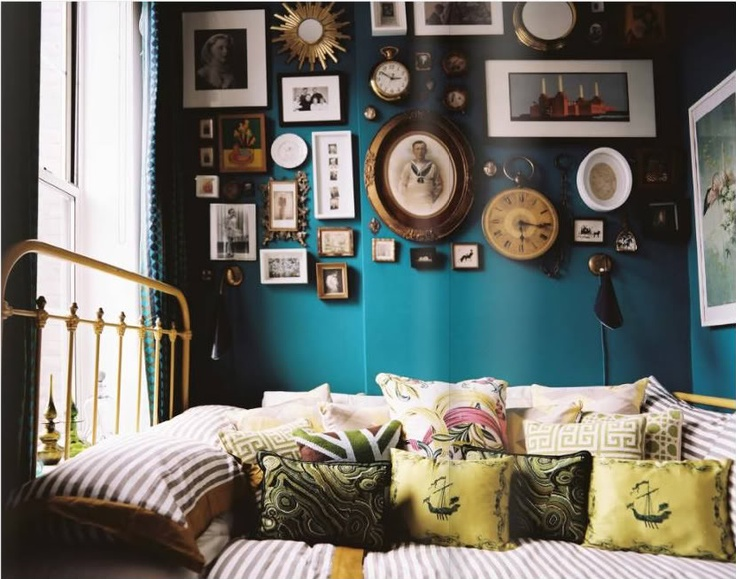 like the teal color mixed with the vintage frames and prints maybe