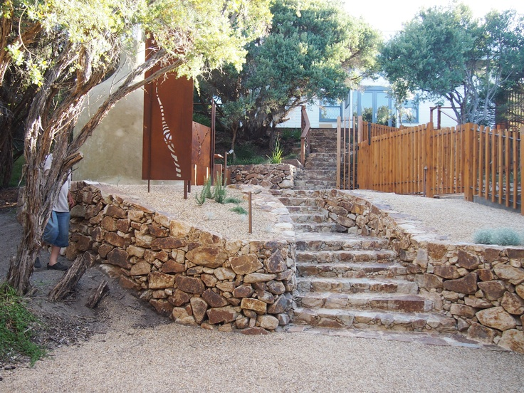 Dry stone retaining wall with stone steps designed and constructed by the team at Abben Art Garden Design